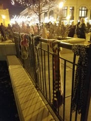 As people gathered for Wausau's Holiday Parade in early December in downtown Wausau, they came across scarves hanging on the railings.