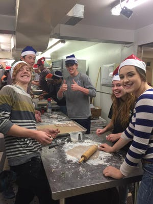 Ruidoso High School students from Mrs. Brown's English class earned their final grade volunteering for the White Apron Society's Cookies for Ella fundraiser.