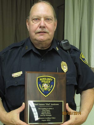 Phil Andrews recently received a plaque from the City of Binghamton to commemorate his 18 years of service with the Binghamton Police Auxiliary.