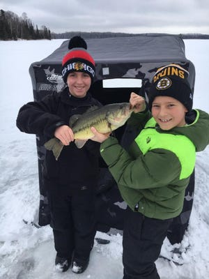 A largemouth bass caught ice fishing on an inland lake.