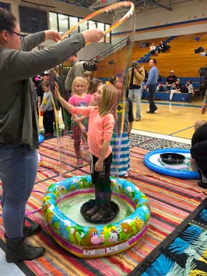 Natalie Hopkins gets wrapped up in a bubble during last year's STEAM events. STEAM 2.0 features events at all three Lansing schools, and at Cornell's Johnson Art Museum and Fuertes Observatory.
