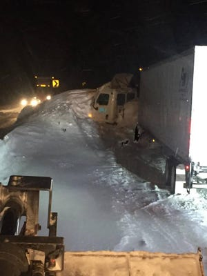 A semi-truck is stuck in an avalanche that buried part of Interstate 70 near Vail on Tuesday.