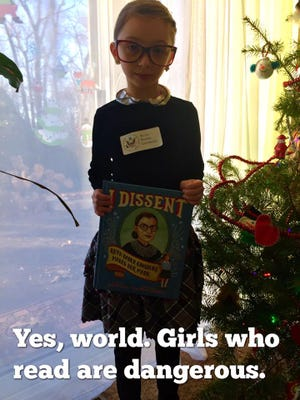 Michele Threefoot dresses up as U.S. Supreme Court Justice Ruth Bader Ginsburg for her school's Superhero Day.