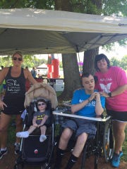 Stacy and Tripp Halstead with Martie and Connor Bode.