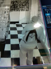 A burglar wearing a distinctive backpack broke into