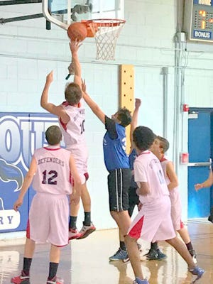 Calvary Christian Academy held its first basketball game last week at Stout Elementary School.