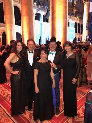 """Anissa Ford, Tom Tinnin, Rocky Galassini, Gene Galassini and Yvette Herrell pose together during the """"Salute to the Armed Services"""" inauguration ball."""
