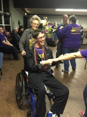 Barbara Brewster of the  Main Street Pilot Club dances with camper Colton Cates at Camp Fleur de Lis.