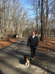 Donna Bealing Elicker walks her sheltie, Lily, at Codorus