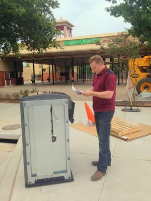 Clayton Lane, a project manager at James Lane Air Conditioning & Plumbing in Wichita Falls, reads instructions in this 2015 photo for a new high-tech Big Belly recycle bin, which was a cooperative effort by the Alcoa Foundation and Downtown Wichita Falls Development. Lane is a past president of the downtown organization and was in Austin on Friday to receive the John Ben Sheppard Pathfinder award for his leadership abilities in his professional career and community.