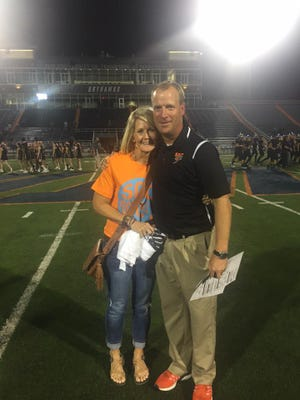 Stacy and Scott Stidham pictured here before South Gibson's football game at Westview last October. Westview plays its home games at UT Martin's Hardy Graham Stadium, which is where Scott proposed to Stacy in 1993 at the 50-yard line.