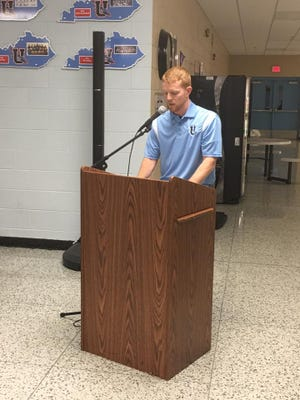 Phillips speaks to the crowd at the press conference held to announce his new position as head basketball coach at UCHS.