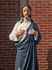The statue of Jesus Christ that sits outside the Cottage Avenue Pentecostal Fellowship on the city's south side has twice been decapitated this month. It is shown here after it was decapitated around Feb. 10 and recently repaired. It has since been decapitated again and the head stolen.