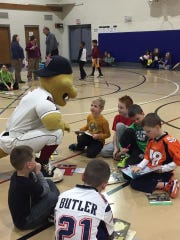 """Fang, from the Wisconsin Timber Rattlers, stopped by Fox Valley Christian Academy recently and showed kids how to hit a """"home run"""" with their reading incentive program. Students are excited to participate and earn tickets to see the Timber Rattlers this spring."""