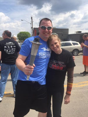Watertown Police Officer Steve Rehorst with Special Olympics athlete Dawn. Both will be running the Law Enforcement Torch Run at the International Special Olympics Winter Games in Austria in March 2017.