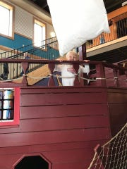Mason Rosolack hangs out on the pirate ship at the Children's Play Gallery in Oconomowoc