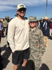 Emily Lenyo with her fiance, now husband at her graduation from basic training.