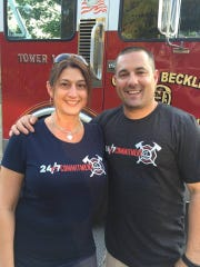 Harrisburg Bureau of Fire Lt. Dennis DeVoe with his wife Amy.