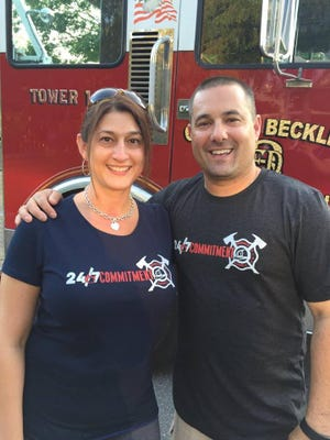 Harrisburg Bureau of Fire Lt. Dennis DeVoe with his wife Amy.