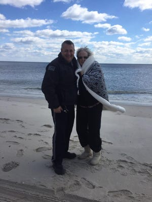 Ship Bottom Police Officer Ron Holloway helped Pat Kelly of Burlington City fulfill her final wish by taking her for a walk on the beach.