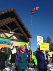 Indivisible Northern Door County members gather outside the Sister Bay post office Wednesday, March 15, 2017.