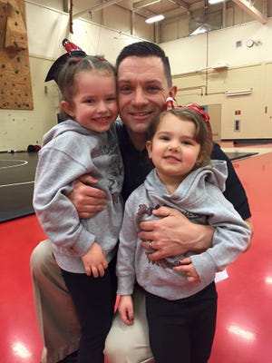 Hunterdon Central wrestling coach Jon Cantagallo-Rohm with his daughters Giulianna (to the left) and Giavanna.
