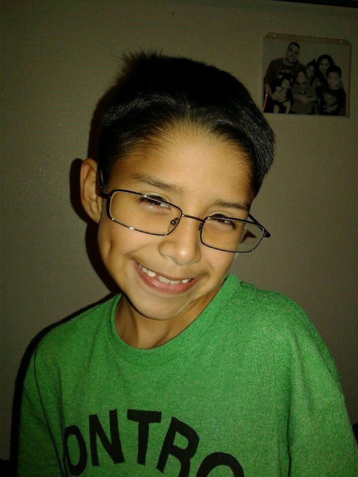 Isaac, Jr. smiling at home.