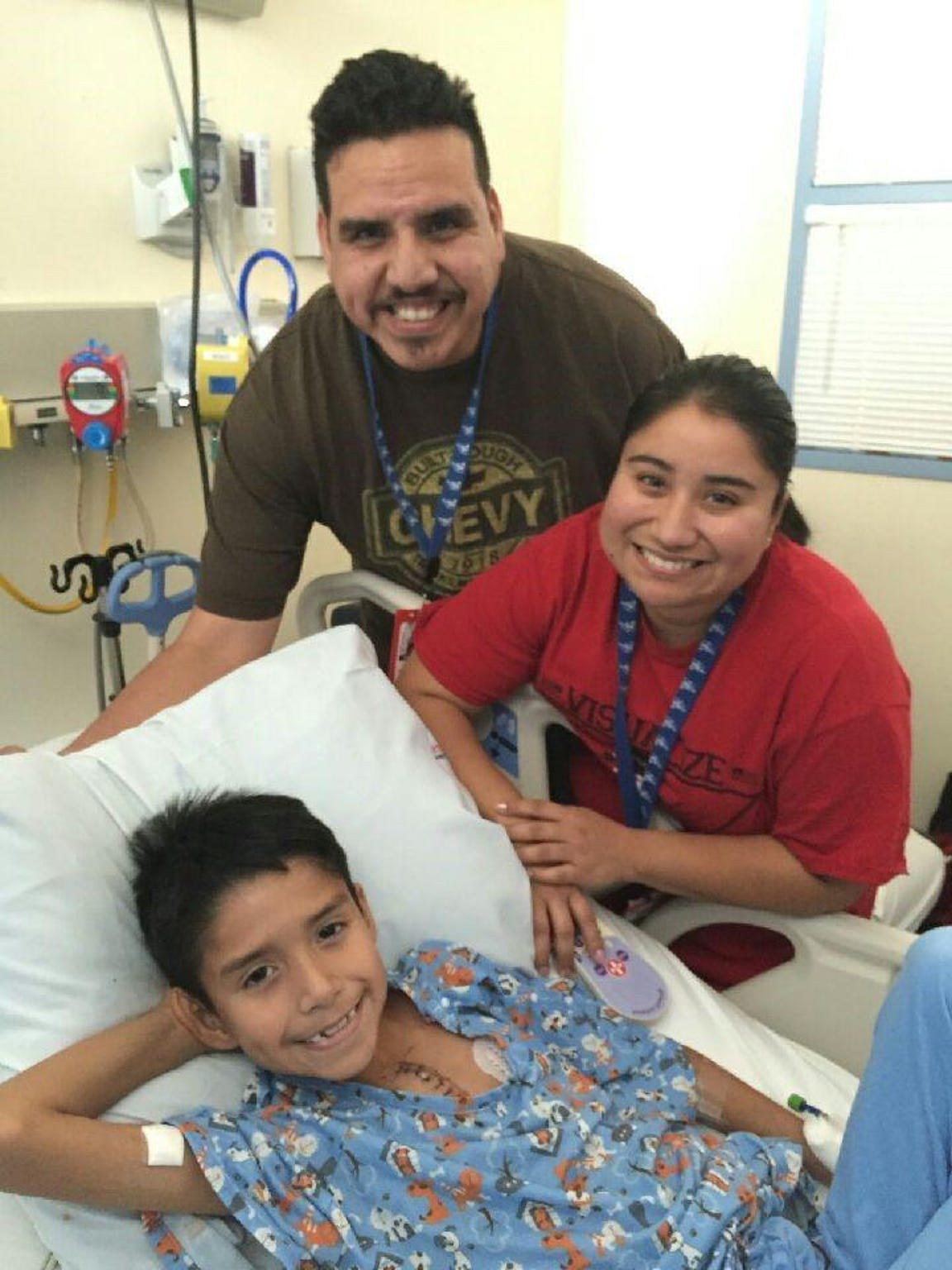 Parents Isaac, Sr. and Samantha Guajardo with their son, Isaac, Jr. following heart surgery.