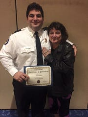 Rush Roberts with mom Donna Roberts Mitchell upon receiving his certification.