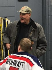 Former Red Wing and current announcer Mickey Redmond stopped by the locker room to give the Wild Wings a pep talk.