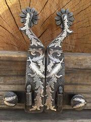 John Jennings of Shawnee, Oklahoma, makes spurs and buckles, like the ones pictured, and will be one of the artists at Cowboy True this weekend.