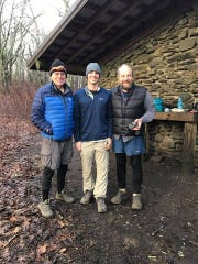 """Dave """"Shortstop"""" Smith, left, Matt Hall and Bert """"Wildcat"""" Emmerson at Jenkins Shelter on the Appalachian Trail near Cades Cove in the Great Smoky Mountains National Park"""