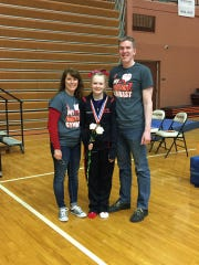 Family love and support helped get Jana Hilditch through her ordeal this year. Here, Jana is flanked by parents Gina and Jim Hilditch following another medal-winning event.
