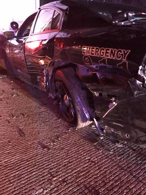 A Riverdale patrol vehicle was damage after a Mini Cooper crashed into it on Route 287 Wednesday.