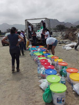 Members of Rotary in Trujillo, Peru, help the community with supplies following the devastating flooding there.