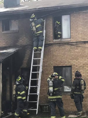 Firefighters with the Indianapolis Fire Department battle a blaze in the Pangea Vista Apartments on April 11, 2017. The fire was later ruled an arson by investigators.