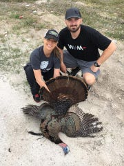 Taylor and Krystle on a successful turkey hunt.