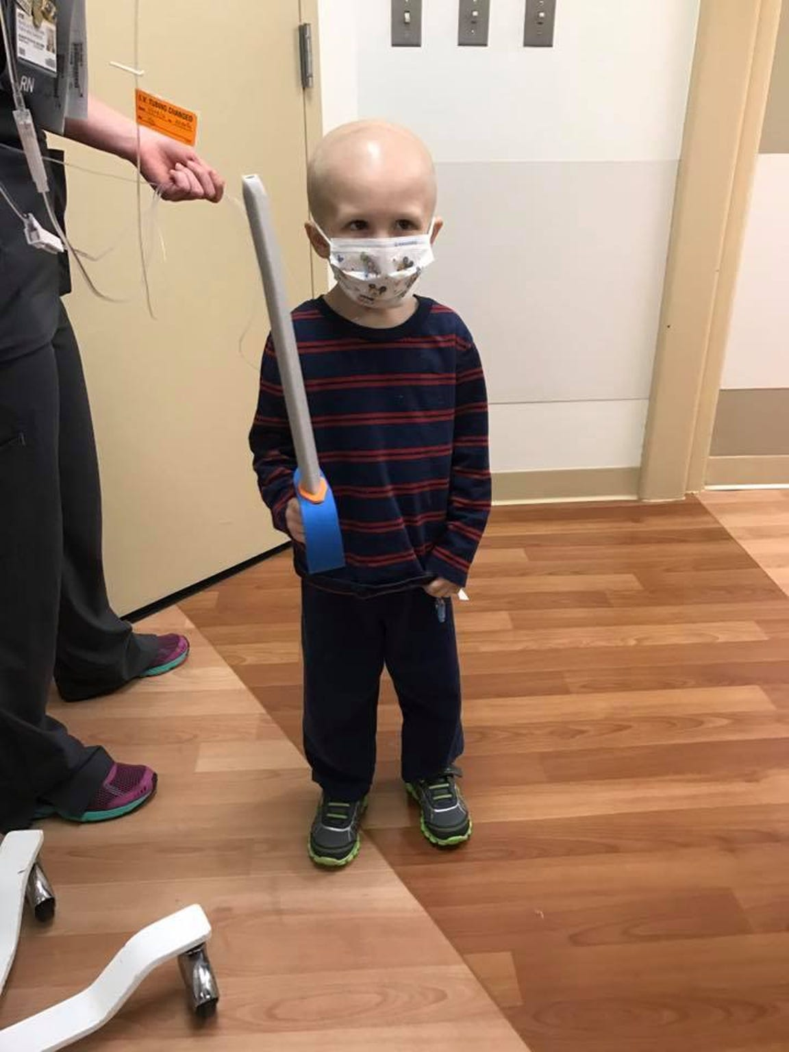 Nolan plays with a toy in the hospital.