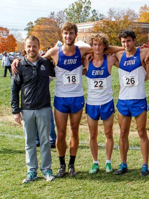 Britten Olinger, who stands on the far left, takes a picture with track and field athletes from Eastern Mennonite University at a meet. He coached track and field at EMU from 2011-16 before he began coaching at Montreat College in July 2016. Olinger was paralyzed from the chest down after a car accident Feb. 27 in Black Mountain.