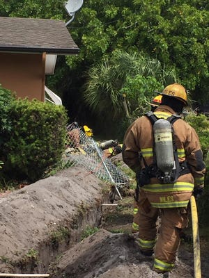 St. Lucie County Fire District crews battle a gas leak April 15, 2017, in the 600 block of Azalea Avenue in Fort Pierce.