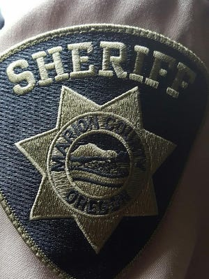 A Marion County deputy and two patrons at a Keizer Station store worked together to resuscitate an unconscious woman Friday afternoon.
