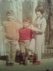 Vanderbilt baseball player Julian Infante's father Joseph (left) with his brother and sister after they arrived in the United States from Cuba in 1962.