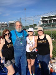 Russell Strange poses with his three daughters - Jennifer Stevens, Emily Falco and Kimberly Strange - at 2016's Kentucky Derby. His youngest daughter, Emily, celebrated her bachelorette party at the track that day.