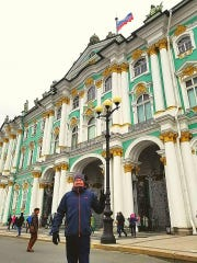 Jeremy Rogers poses in front of the Hermitage Museum in Saint Petersburg, Russia.