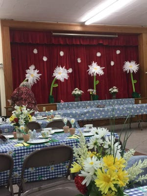 The Danby Church community room is decked out in a daisy theme for the Ladies' Tea Party.