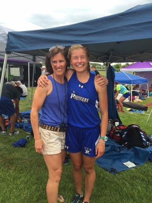Peggy Regan stands with Croswell-Lexington senior Calli Townsend. Regan will soon retire after coaching 30 years.