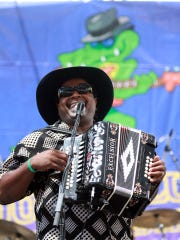 """Blues artist Nathan Williams from the band """"Zydeco Cha-Chas"""" sings and plays the accordion during the 23rd annual Simi Valley Cajun and Blues Festival."""