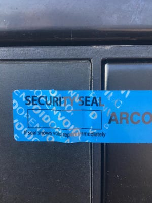 Security tape on credit card readers on gas pumps will show a warning if it has been broken.