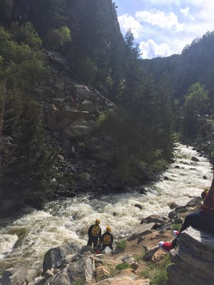 The Rocky Mountain Rescue Group and other emergency crews work to rescue a fallen rock climber who fell about 50 feet in the 33,200 block of Boulder Canyon in Boulder County, CO Sunday May 28, 2017.