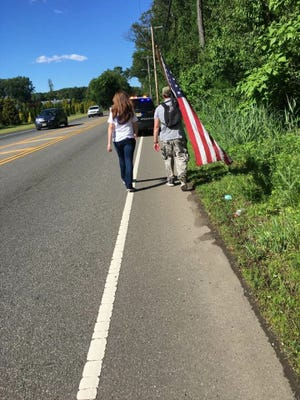 Holmdel Police Officer and veteran Michael Dowens walked from Washington, D.C. to East Brunswick last week to raise awareness and funds for veterans with post-traumatic stress disorder.